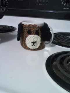 http://www.redheart.com/free-patterns/puppy-mug-hug